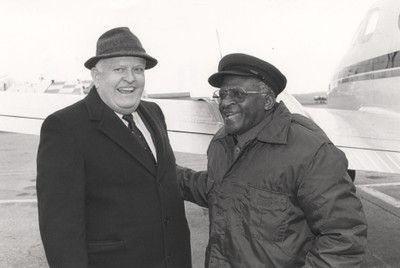 Seen here with civil rights activist Desmond Tutu, Penn State President Bryce Jordan formally announced the inauguration of EOPC on August 17, 1983.