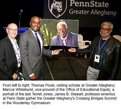 From left to right: Thomas Poole, visiting scholar at Greater Allegheny; Marcus Whitehurst, vice-provost of the Office of Educational Equity; aportrait of the late Terrell Jones; James B. Stewart, professor emeritus at Penn State gather the Greater Allegheny's Crossing Bridges Summit in the Wunderley Gymnasium.