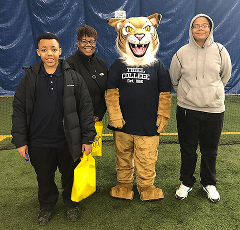 Farrell students pose with Thiel College tiger mascot.
